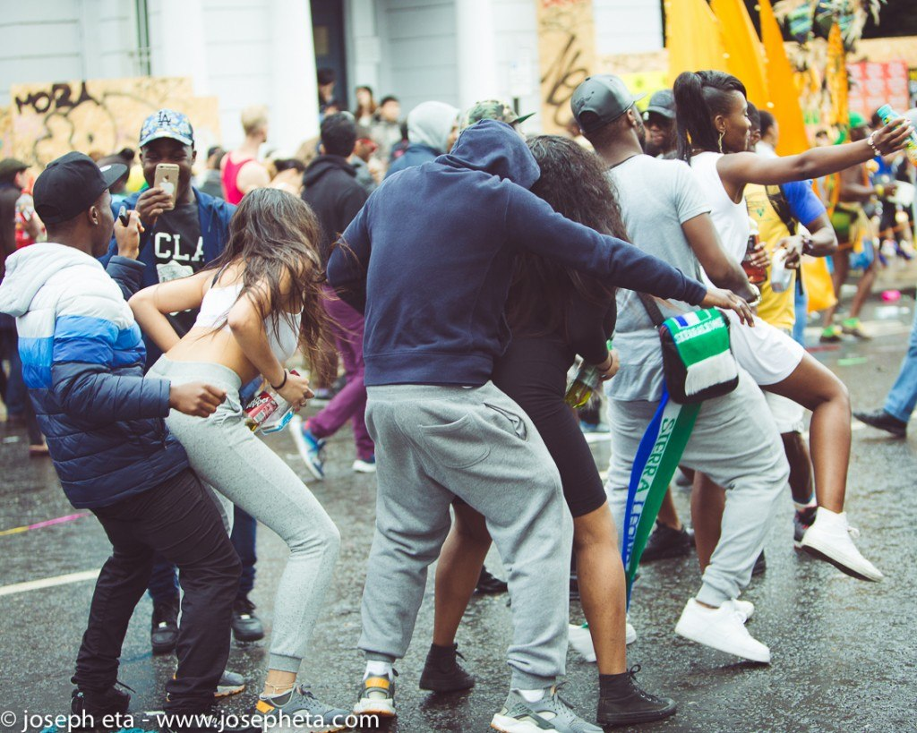 a photo of a group of people dancing at the London Notting Hill Carnival