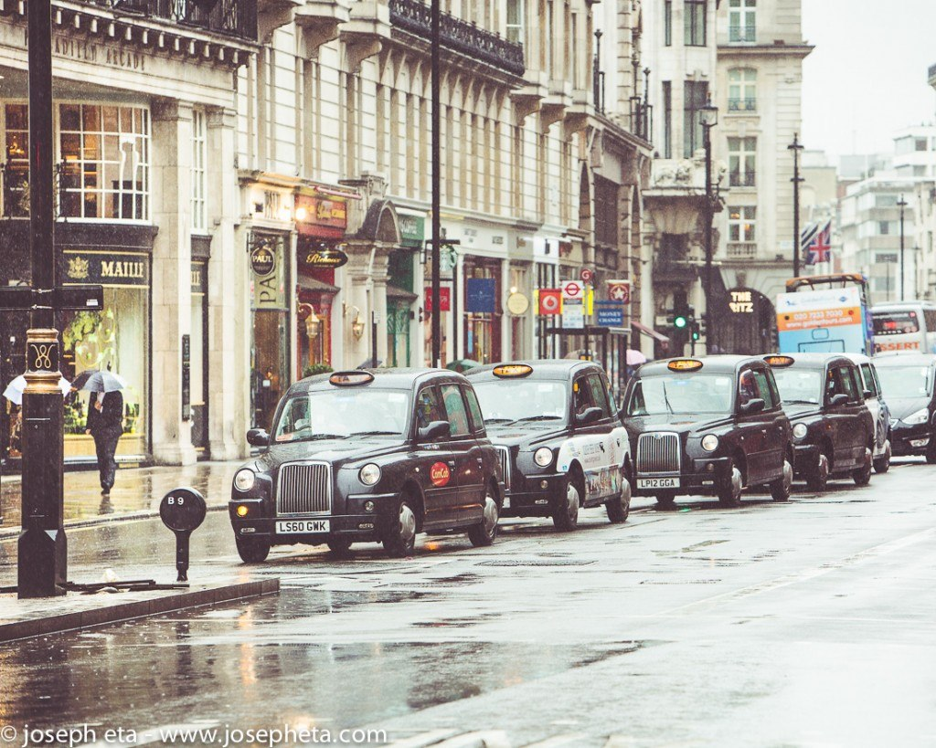 street photopgraphy of London black taxis in the rain