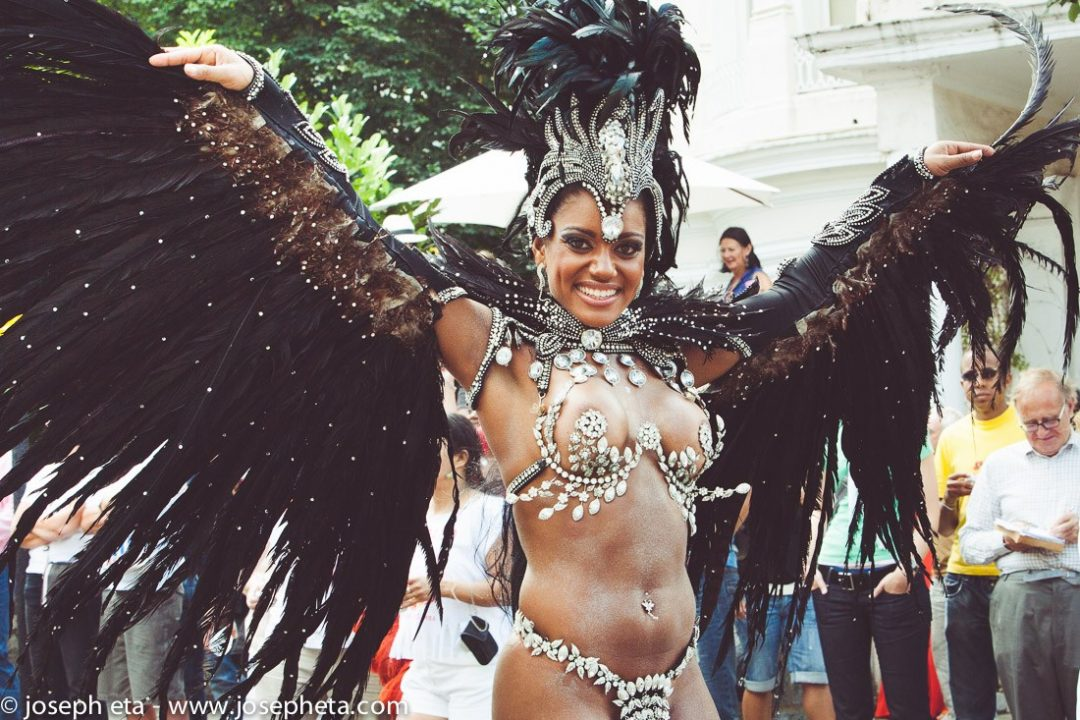 Carnival dancer with angel wings at the London Notting Hill Carnival