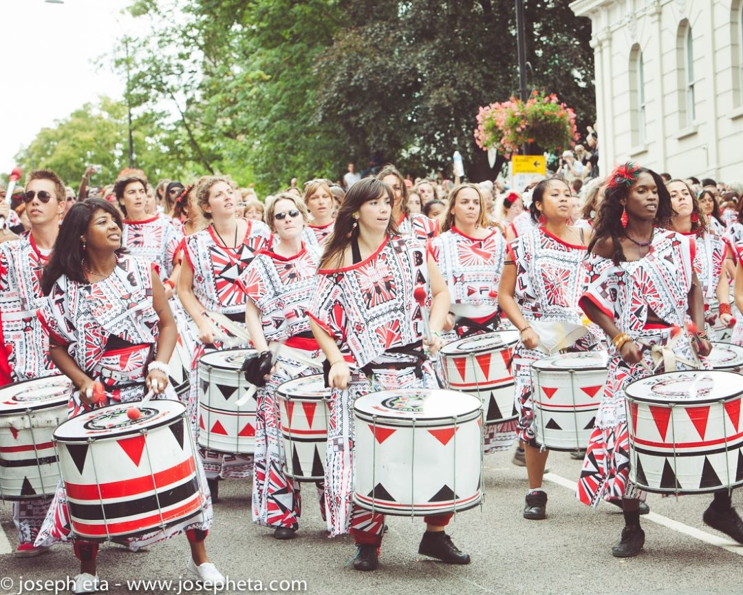 photo of a carnival band drumming samba during the Notting Hill Carvinal in London