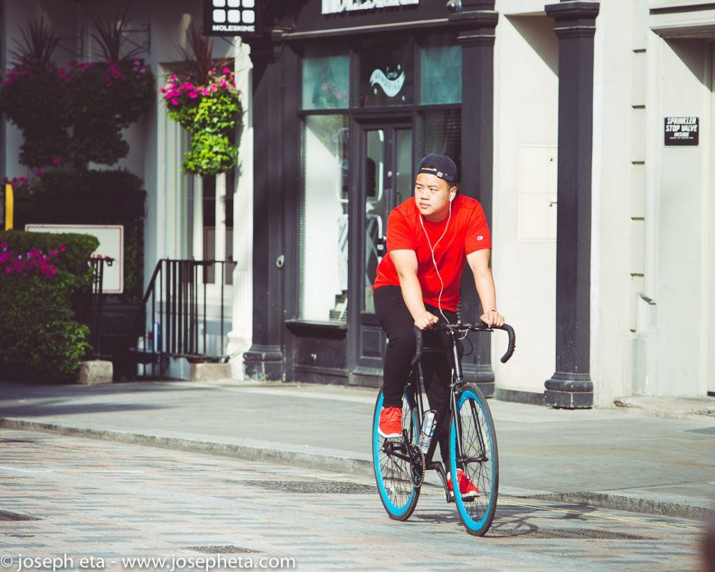 A cyclist riding his bicycle in Covent Garden in London