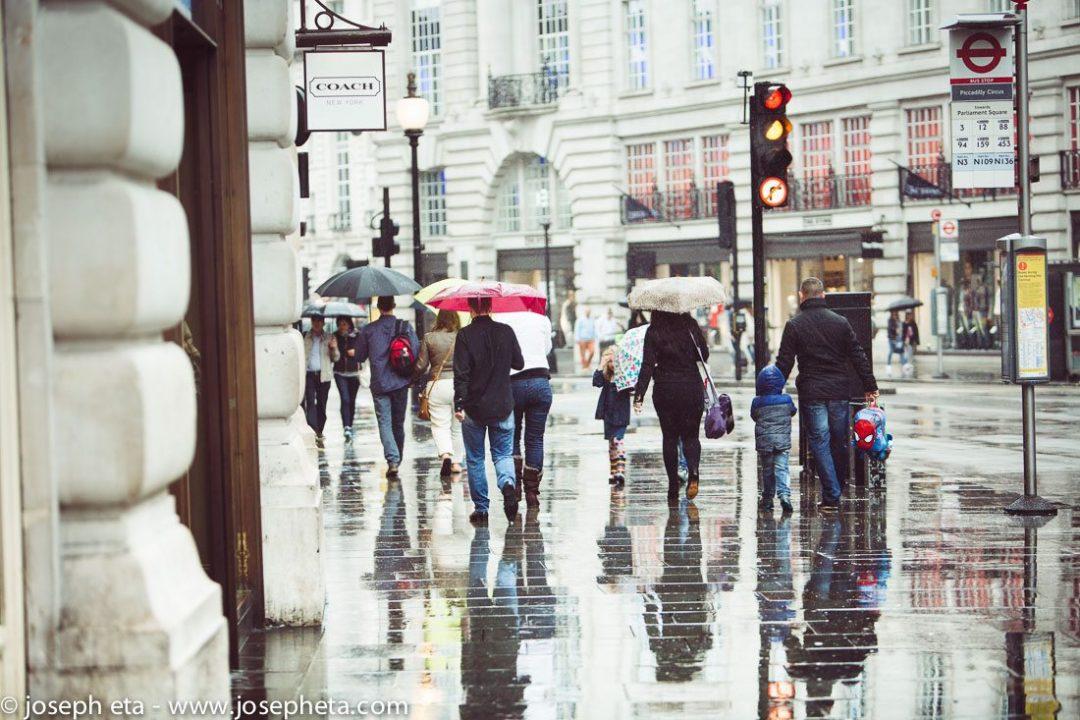 People under their umbrellas walking down Regents street in London