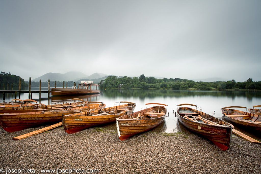 Boats at the shores of lake Derwentwater in the Lake district in the UK