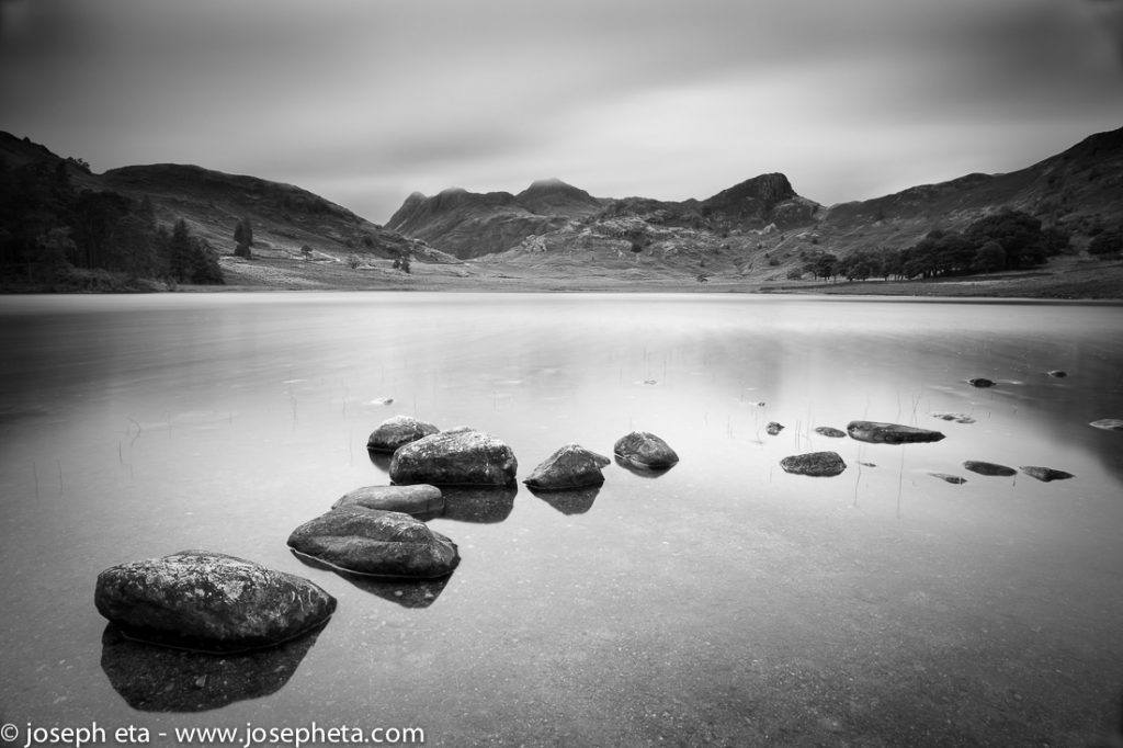 A small lake called Blea Tarn in the Lake District in the UK