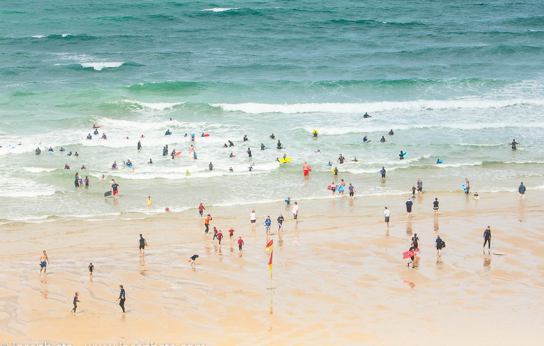 photo of teenagers learning how to surf at Fristal Beach in Cornwall