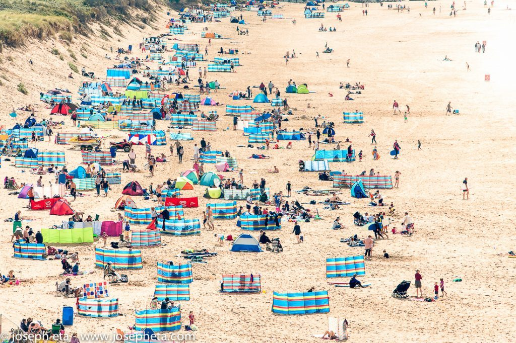 Photo of sun bathers at Fristal beach in Newquay in Cornwall