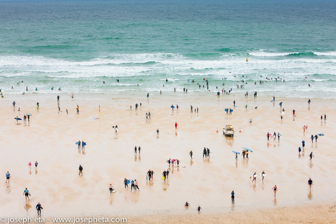 A photo of surfers at Fristal beach in Newquay in Cornwall