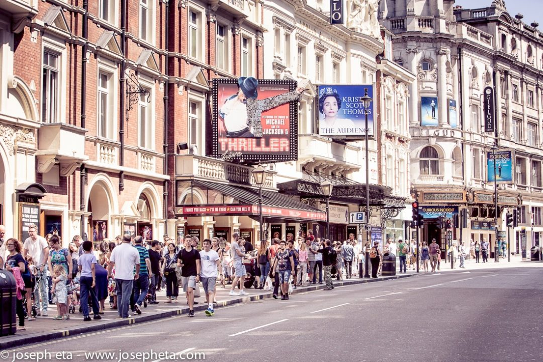 A photo of people walking along shaftesbury avenue in Piccadilly in London