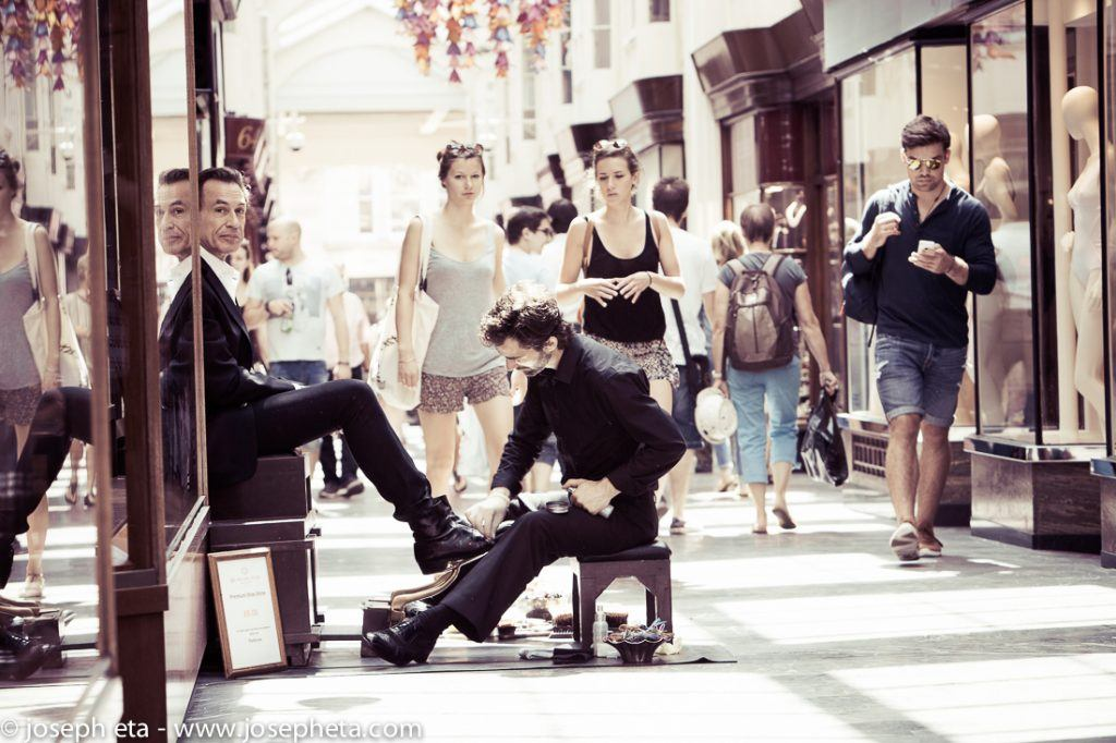 A shoeshiner in the Burlington Arcade in Piccadilly in London