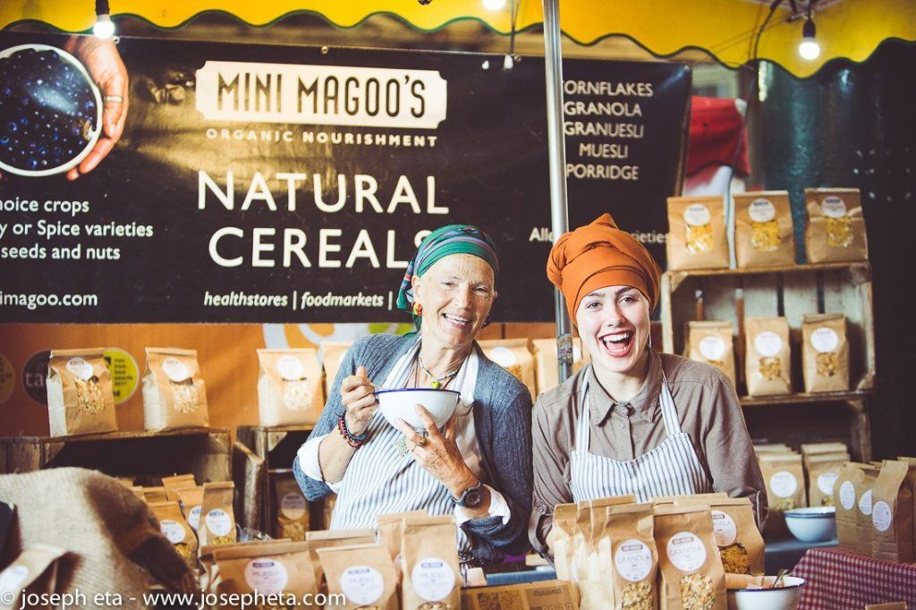 Two women selling natural cereals at London Borough Market