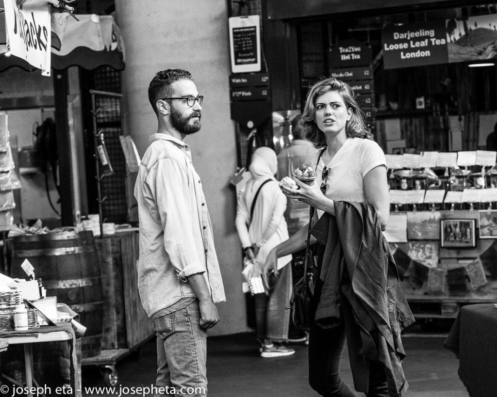 A couple walking around London Borough Market