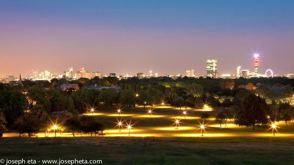 An image of Primerose Hill Park in London at night