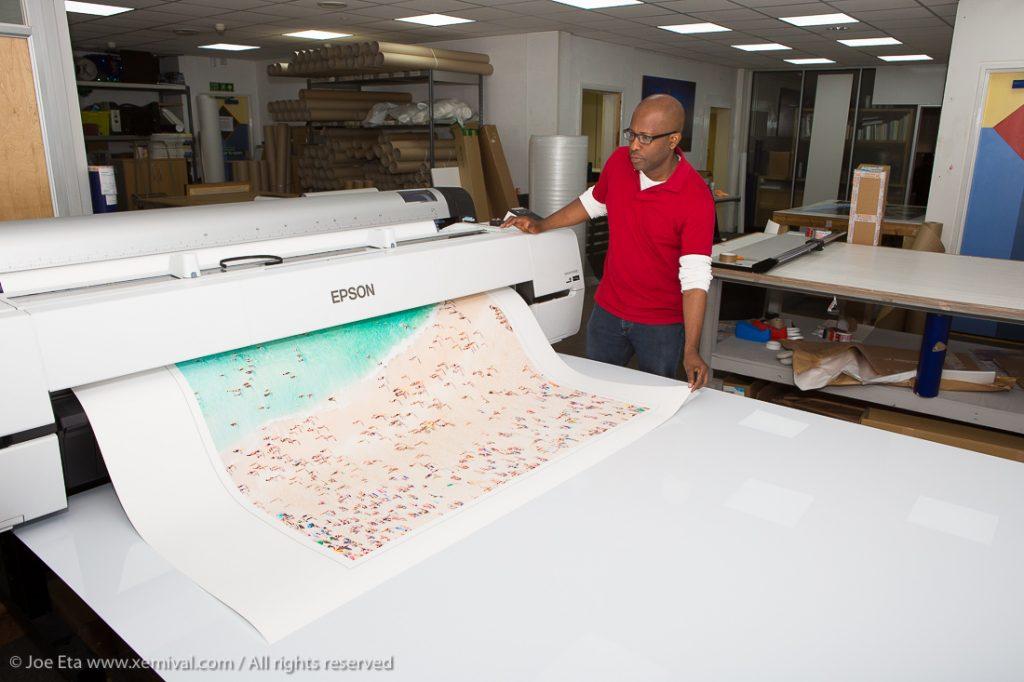 joseph eta inspecting a fine art print