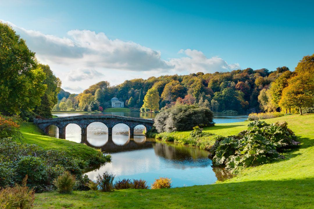 An autumn sunrise over Stourhead Gardens in Wiltshire.
