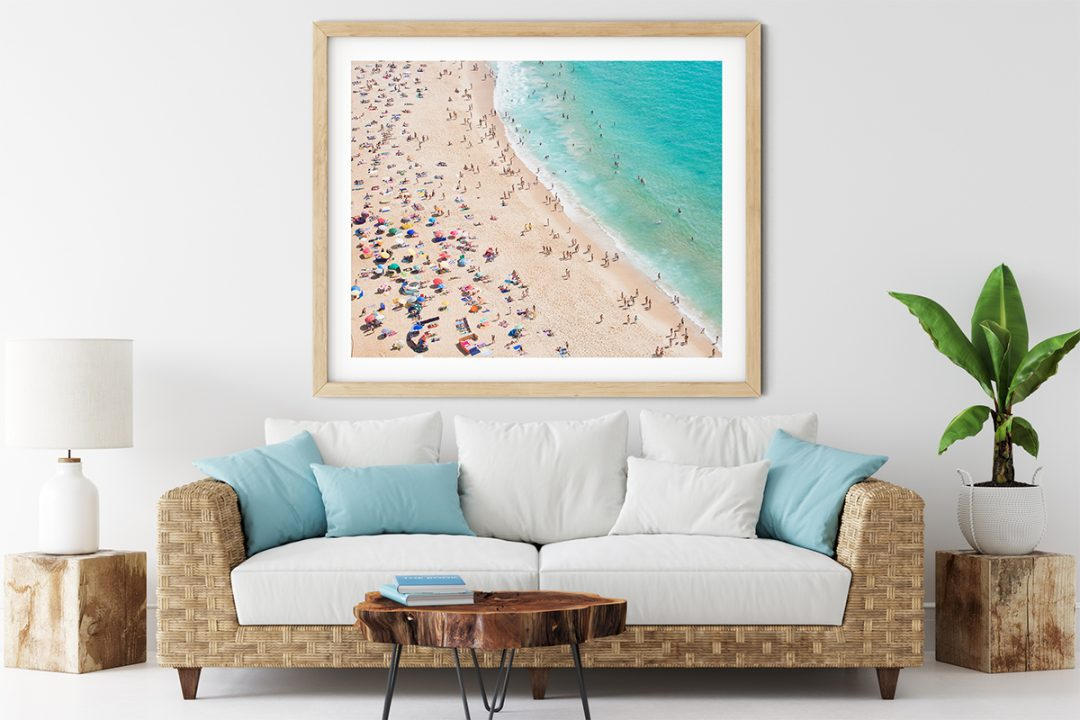 Beautiful framed aerial beach print in a beach interior