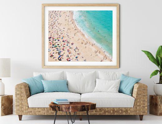 Beautiful framed aerial beach print in a beach interior
